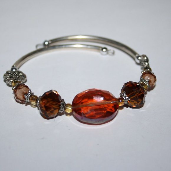 Stunning silver and orange crystal coil bracelet